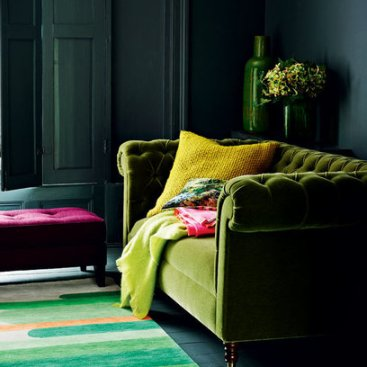 Dark-Living-room-with-Green-velvet-Couch-Red